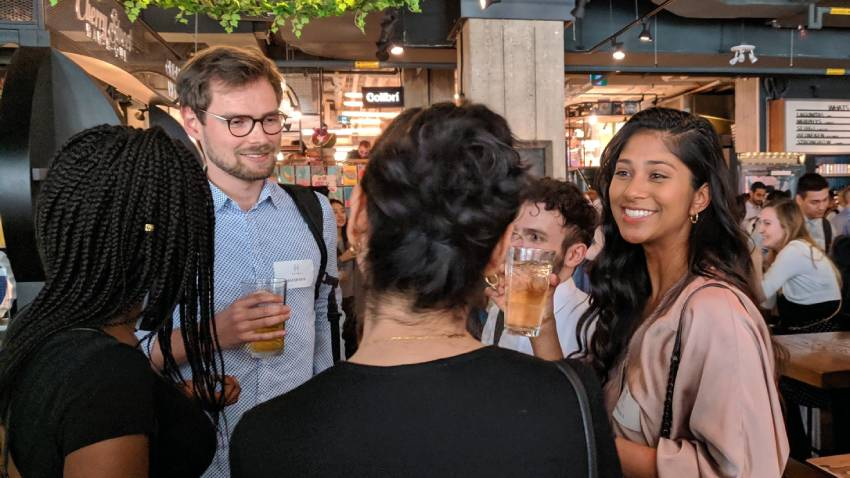 people talking in circle at networking event